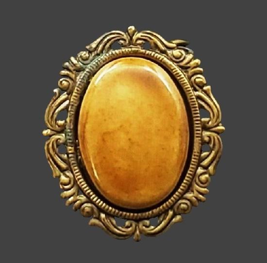Caramel color cabochon antique gold tone frame oval shaped scarf dress clip