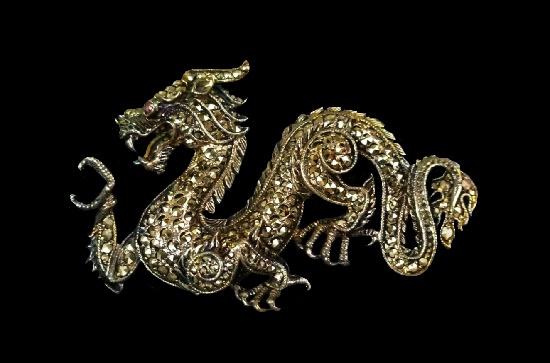 Dragon brooch. Sterling silver marcasite, ruby eye
