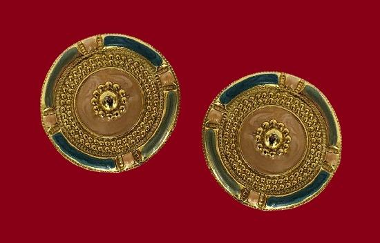 Ornamental round shaped gold tone enamel pierced earrings. 1980s