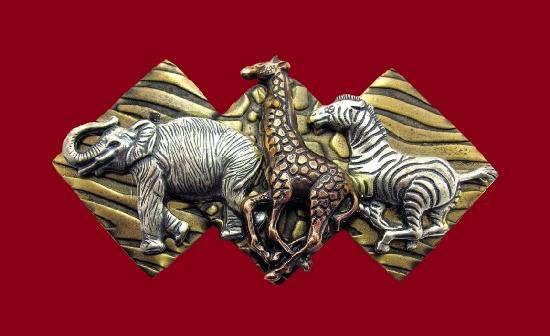 Wild animals - elephant giraffe, zebra brooch pin. Mixed metals. 8.3 cm. 1980s