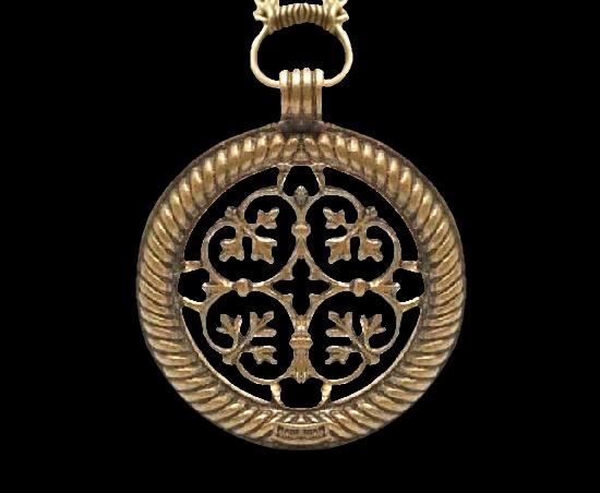 1950s ornate bronze pendant inspired by archaeological findings in Tuukkala. Bronze. 4.5 cm. 1980s