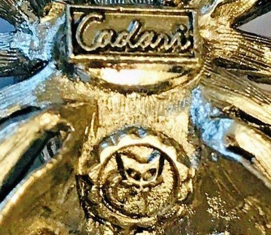 Cadari signature with cat's head mark