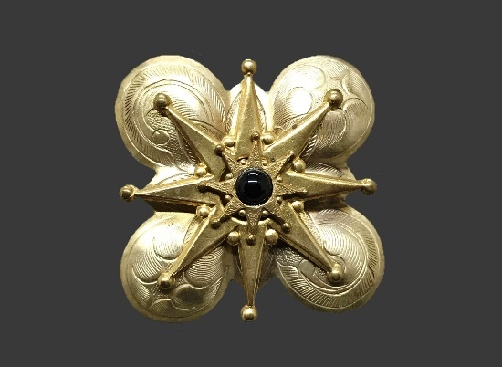 Eight-pointed Star brooch. Gold tone textured metal, black onyx
