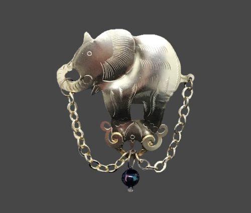 Elephant gold tone brooch. Metal alloy, glass bead. 1990s