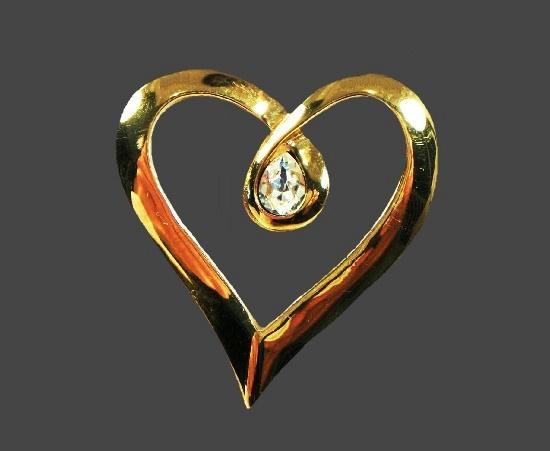 Gold tone rhinestone heart brooch. 1980s