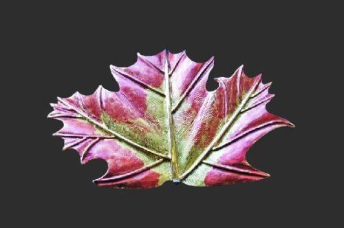 Maple leaf gold tone enameled brooch
