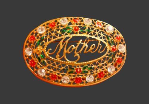 Mother oval shaped brooch. Gold tone, rhinestones, enamel. 5.8 cm. 1970s