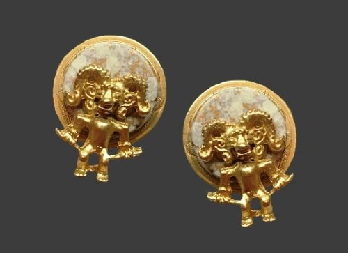 Mythological creature against round disc pierced earrings. Gold tone alloy, marble tone stone