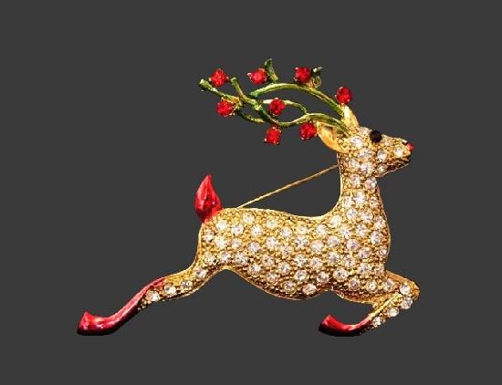 Reindeer Christmas brooch pin. Gold tone, rhinestones. 10 cm. 1970s